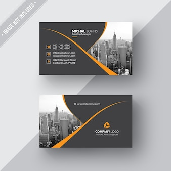 Black business card with orange details