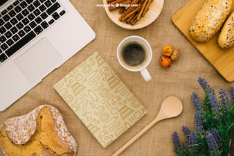Book cover composition with breakfast and laptop