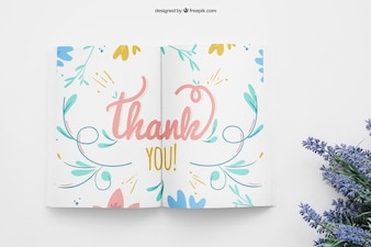 Book mockup with wildflowers