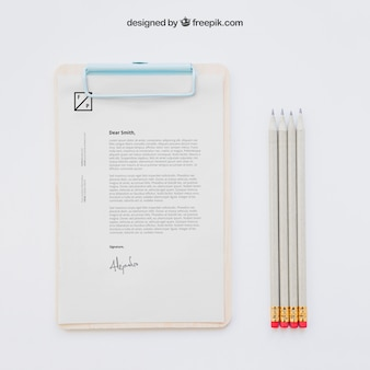 Business concept with clipboard and pencils