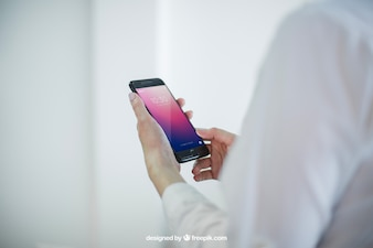 Business mock up with hands holding smartphone