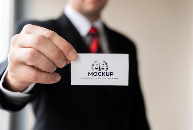 Businessman holding business card mock-up with one hand