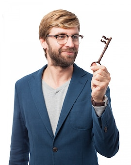 Cheerful businessman holding an old key