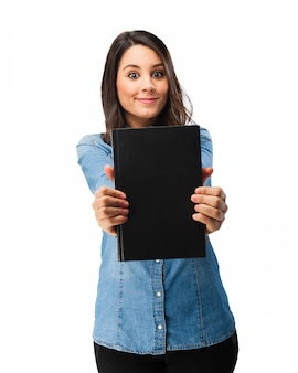Cheerful student showing her book with black cover