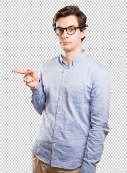 Confident young man pointing