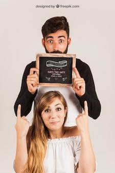 Couple showing slate