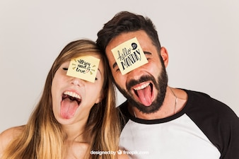Couple with post its on face