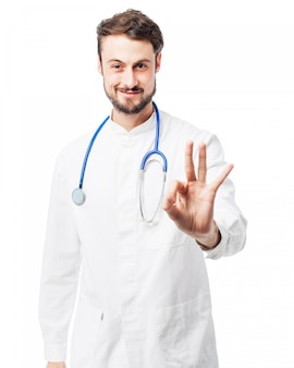 Doctor says  ok  with his hand