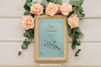 Flowers and leaves around wooden frame