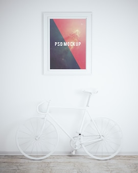 Frame on white wall with white bicycle mock up
