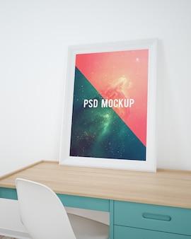 Frame on wooden desk mock up