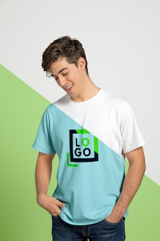 Front view of man posing while wearing t-shirt