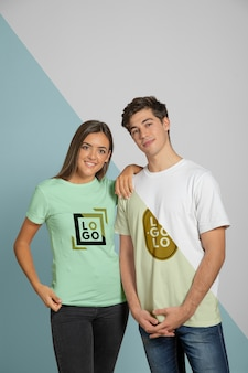 Front view of man and woman posing in t-shirts