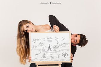 Funny couple with whiteboard