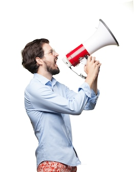 Furious businessman using a bullhorn
