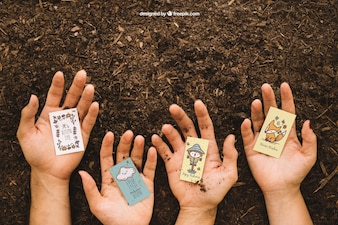Gardening mockup with hands holding cards