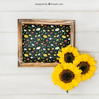 Gardening mockup with slate and three sunflowers