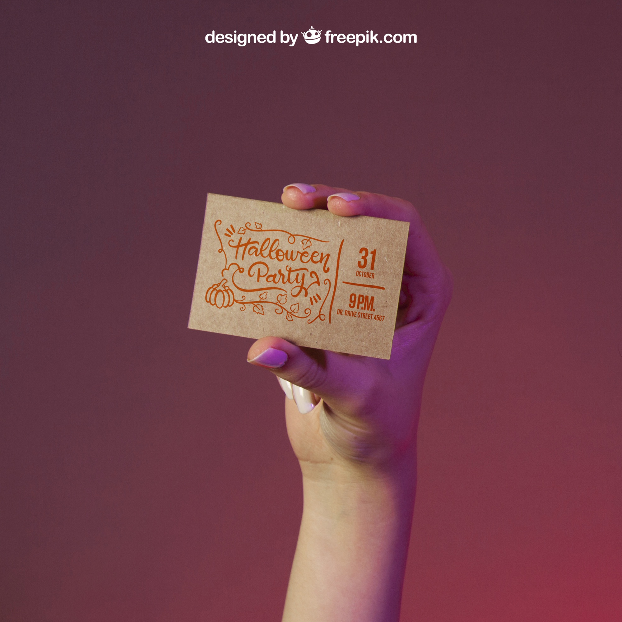Halloween mockup with hand holding business card