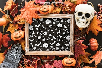 Halloween slate mockup with skull and tombstone on leaves