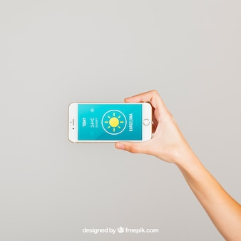 Hand holding smartphone horizontal