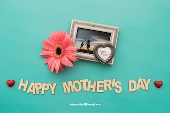 Happy mothers day lettering and photo frame with flower