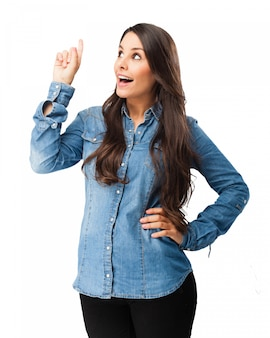 Happy woman pointing with her right hand up