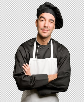 Happy young chef winking an eye