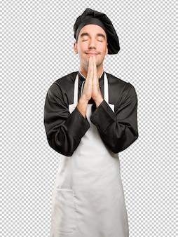 Hopeful young chef praying