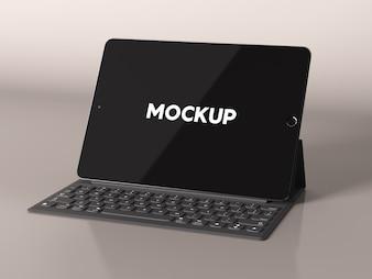 光沢のある背景にキーボードでIpadはデザインをモックアップ
