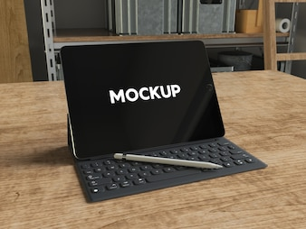 Ipad with keyboard on wooden table mock up design