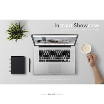 Laptop and hand holding a cup of coffee mock up