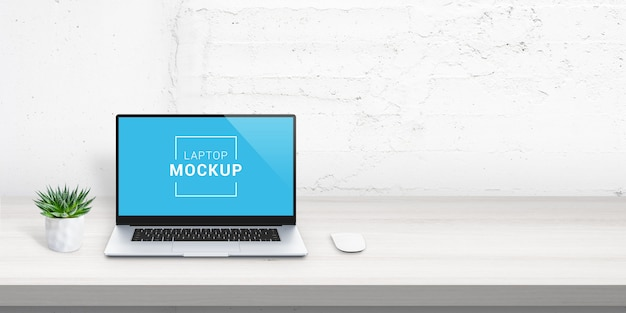 Laptop mockup on office desk with free space beside for promo text. plant and mouse beside. white brick wall in background. scene creator with isolated layers