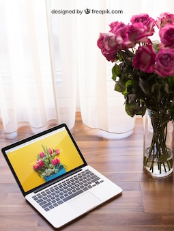 Laptop mockup with flowers