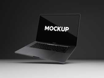 Laptop on black background mock up design