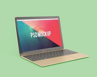 緑の背景にノートパソコンをモックアップ