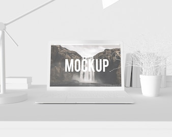 Laptop on white desk mock up