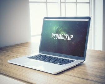 Laptop on wooden desk background mock up