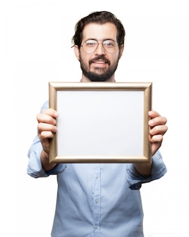 Man with glasses holding a frame