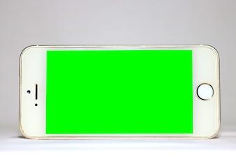 分離された白い背景を持つモバイルグリーンスクリーン