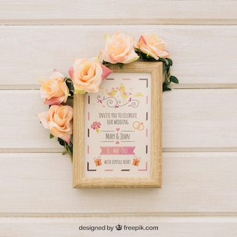 Mock up design of wooden frame with flowers