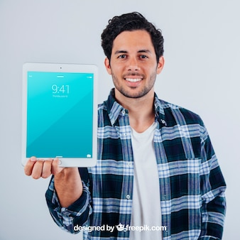Mock up design of young guy with tablet