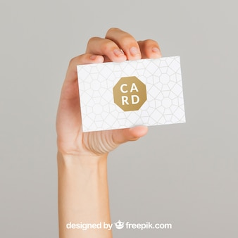 Mockup concept of hand and business card