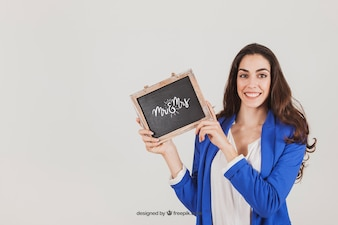 Mockup design of smiling woman with slate