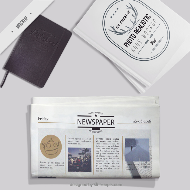 Mockup of newspaper with notebook and photo book