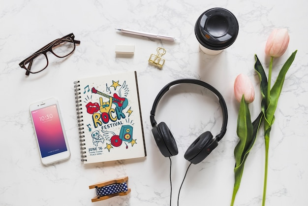 Music mockup with headphones and various objects