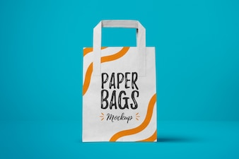 Paper bag on blue background mock up