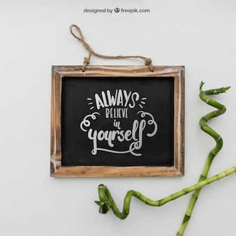 Quote on chalkboard with bamboo