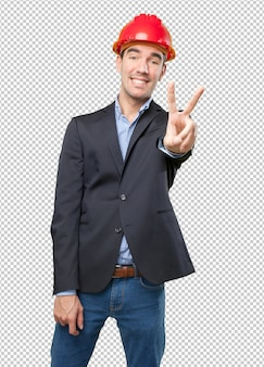 Satisfied architect with victory gesture