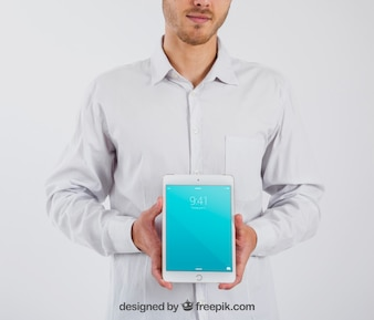 Smart businessman holding tablet