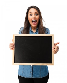 Surprised student with a blackboard